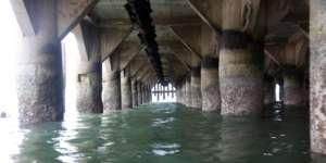 Underneath ocean pier.